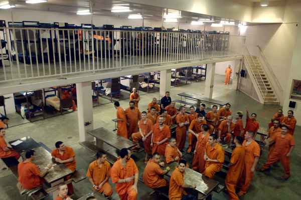 A large group a male inmates in a common space in Canyon County Jail