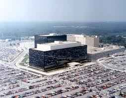 The NSA building from a distance, shown with parking lots surrounding it.
